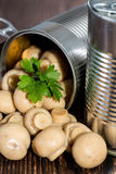 Canned Mushrooms on wood Royalty Free Stock Photo