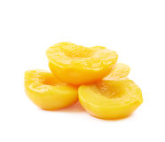 Canned peach half isolated. Pile of canned peach fruit's halves isolated over the white background Royalty Free Stock Images