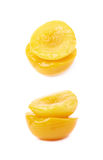 Canned peach half isolated Stock Images