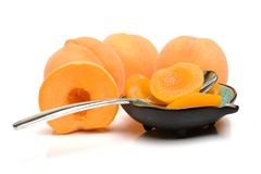 Canned peach halves in bowl. Isolated on white background stock images