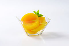 Canned peach halves royalty free stock photography