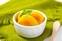 Canned peach halves royalty free stock images