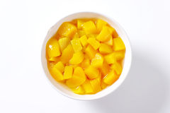 Canned peach pieces royalty free stock images