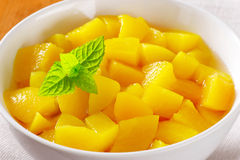 Canned peach pieces stock photo