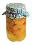Canned peaches jar. Jar of home canned peaches isolated on white Stock Images