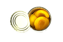 Canned peaches on white background Stock Image