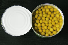 Canned peas on black royalty free stock image