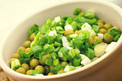 Canned peas with chives in ceramic bowl on wooden background. He Stock Photos