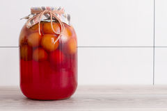 Canned plums. Plums in a glass jar close up Stock Images