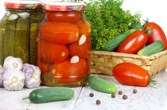 Canned, preserves tomatoes, cucumbers in the pot a Stock Images