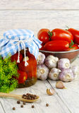 Canned, preserves tomatoes in the pot and fresh to Stock Photos