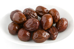 Canned prunes on a dish  Royalty Free Stock Images