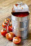 Canned raw food and tomatoes. On wooden table stock images