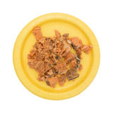 Canned salmon on a yellow plate top view Stock Photo