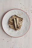 Canned sprats on dish Stock Photos
