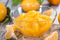Canned Tangerines. Some Canned Tangerines with fresh fruits Stock Photo