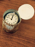 Canned time concept.Time preserved in tin can on wooden table. Canned time concept.Time preserved in tin can on wooden table taken closeup Stock Image