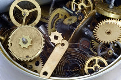 Canned time - parts of clockwork mechanism in the can Royalty Free Stock Photo
