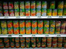 Canned tinned fruit section in gourmet supermarket. A photo showing the large selection of colorful canned assorted fruits on the shelves of a modern gourmet Royalty Free Stock Images