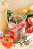 Canned tomatoes and cucumbers Royalty Free Stock Photos