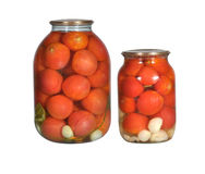 Canned tomatoes in glass Bootle Stock Photography