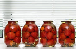 Canned tomatoes in large glass jars. Stock Image