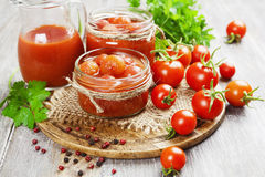 Canned tomatoes in tomato juice Royalty Free Stock Photos