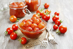 Canned tomatoes in tomato juice. On a wooden table Royalty Free Stock Image