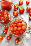 Canned tomatoes in tomato juice Stock Images