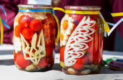 Canned tomatoes with Ukrainian national symbols Royalty Free Stock Images
