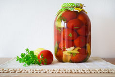 Canned tomatoes on wooden table Stock Photos