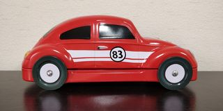 Canned toycar piggy bank stock photography