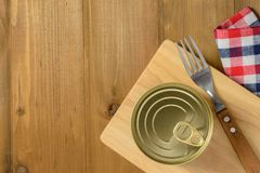 Canned tuna. On a wooden table, topview Stock Images