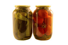 Canned vegetables cucumbers and tomatoes Royalty Free Stock Photo