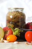 Canned vegetables cutting board eggplant tomato garlic Royalty Free Stock Photography