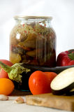 Canned vegetables cutting board squash tomato garlic Royalty Free Stock Photography