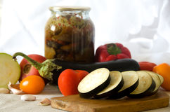 Canned vegetables eggplant squash tomato garlic Stock Image