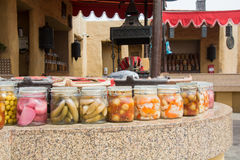 Canned vegetables and fruits on the tables at the arabian kitchen Stock Photos
