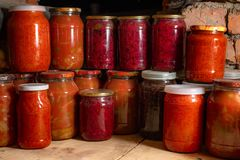Canned vegetables in glass transparent jars stock image