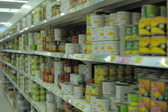 Canned vegetables on store shelves Royalty Free Stock Image