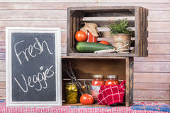 Canned Vegetables in wooden crates with chalk board Stock Images