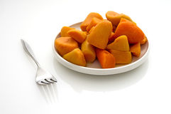 Canned yams on a white reflective table Royalty Free Stock Photography