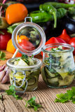 Canned zucchini and fresh vegetables Stock Photos
