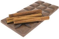 Cannella con una barra di cioccolato Fotografia Stock Libera da Diritti