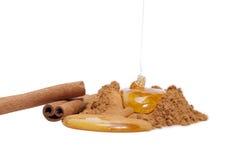 Cannelle et miel photographie stock libre de droits