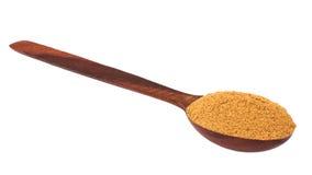 Cannelle moulue dans une cuillère en bois Image stock