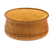 Cannelle moulue de tasse en bois Photographie stock libre de droits