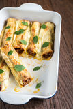 Cannelloni with mincemeat and bechamel Stock Images
