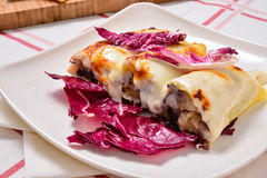 Cannelloni with radicchio and Taleggio cheese fondue Stock Photo