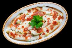 Cannelloni with spinach, ricotta, tomato sauce, bechamel and cheese. Baking dish with cannelloni cannelloni di magro covered with tomato sauce, bechamel and stock photos